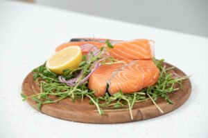 keto diet,salmon and lemon on a wooden plank