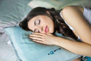 woman sleeping lying on a pillow