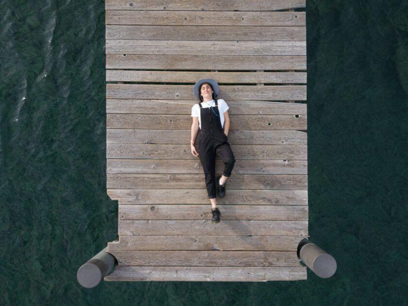 woman lying on a bridge