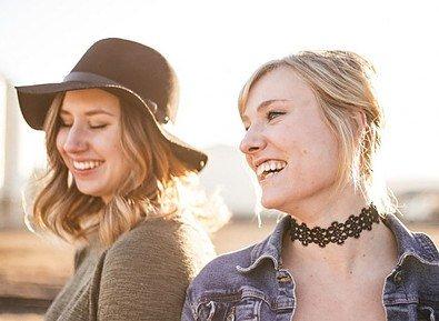 2 women laughing
