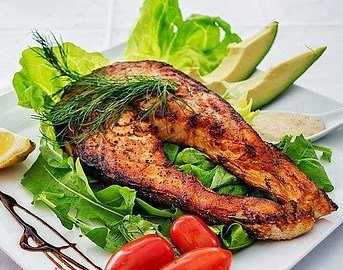 salmon on a dish with lettuce