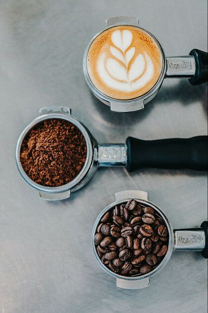 from coffee beans to grounded coffee to a cup of coffee